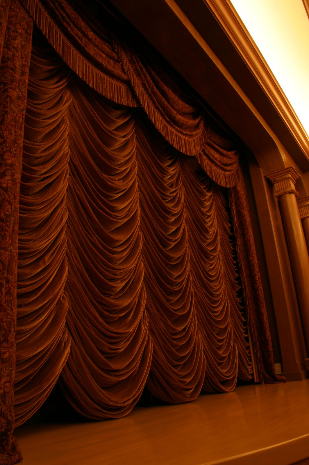 home theater with motorized drape